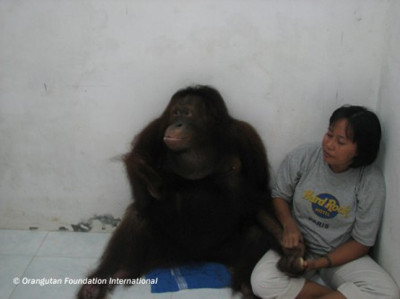 Kiki sitting with one of her caregivers at the Care Center.