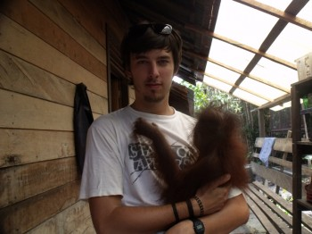 Me at the Orangutan Care Center and Quarantine in Pasir Panjang, holding orphan Bama.