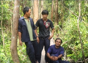 At home in the forest, Pak Ateng (center) with fellow co-workers, Pak Manis (left) and Pak Midi (right)