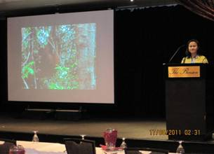 Ibu Maryanti delivering her presentation on OFI's Holistic  Environmental Enrichment Program at the ICEE conference.