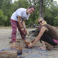 Flore and Esther making enrichment logs for the orangutans at the Care Center to play with.