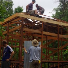 Construction team volunteers hard at work building the frame for the new guard post